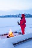 Het verwarmen bij brand royalty-vrije stock afbeelding