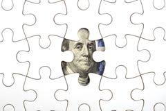 Het verzamelen van dollarbankbiljet met puzzel Stock Foto's