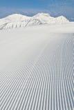 Het verzorgen van de sneeuw machinesporen Royalty-vrije Stock Foto's