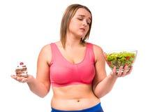 Het vette vrouw op dieet zijn Stock Afbeeldingen