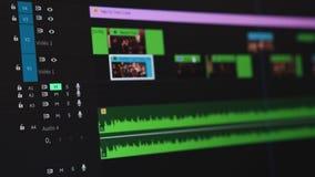 Het video uitgeven op een computer, postproduction, klemmaker 4K stock videobeelden