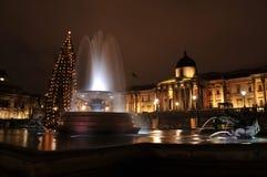 Het vierkant van Trafalgar 's nachts bij Kerstmis Stock Foto's
