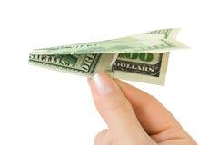 Het vliegtuig van de hand en van het geld Royalty-vrije Stock Foto