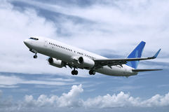 Het vliegtuig van de passagier het landen Stock Foto's