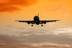 Het vliegtuigzonsondergang van de lucht Stock Afbeelding