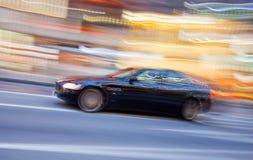 Het Voertuig van de sportwagen in motieonduidelijk beeld Stock Foto's