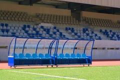 Het voetbal van de bank Stock Foto's