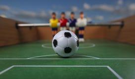 Het voetbal van de Foosballlijst de tijd van de voetbalsterssport Stock Foto's