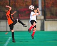 Het voetbalactie van de jeugd stock afbeeldingen