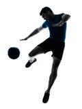 Het voetbalvoetbalster van de mens het vliegen het schoppen stock foto's