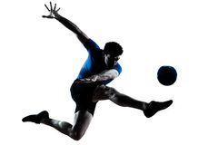 Het voetbalvoetbalster van de mens het vliegen het schoppen royalty-vrije stock afbeeldingen