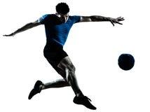 Het voetbalvoetbalster van de mens het vliegen het schoppen royalty-vrije stock foto's