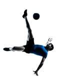 Het voetbalvoetbalster van de mens het vliegen het schoppen Stock Foto