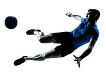 Het voetbalvoetbalster van de mens het vliegen het schoppen royalty-vrije stock afbeelding