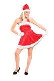 Het volledige lengteportret van een vrouw kleedde zich als Kerstman Royalty-vrije Stock Foto