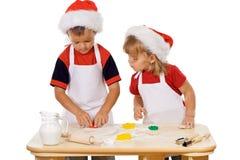 Het voorbereiden van de Kerstmiskoekjes Stock Fotografie