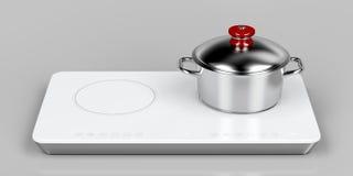 Het voorbereiden van voedsel op inductie cooktop Stock Afbeelding