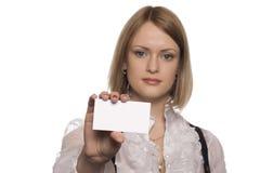 Het voorstellen van haar adreskaartje Stock Foto's