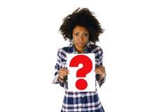 Het vraagteken van de vrouwenholding stock foto