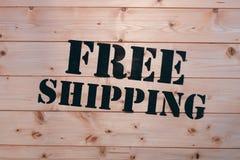 Het vrije verschepen Vrij het Verschepen woord op houten vervoerdoos Vrij Verschepend Pakket Stock Afbeeldingen