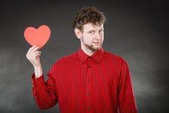 Het vrolijke hart van de mensenholding Stock Fotografie