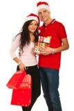 Het vrolijke jonge paar van Kerstmis Stock Afbeeldingen