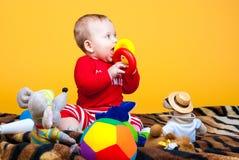 Het vrolijke kind glimlachen Stock Foto