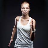 Het vrouwelijke atleet lopen Royalty-vrije Stock Foto's