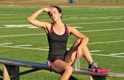Het vrouwelijke atleet rusten Royalty-vrije Stock Afbeelding