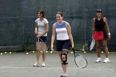 Het vrouwelijke tennisspelers lachen Stock Foto's