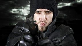 Het vurenkanon van de geheim agent in de camera Stock Afbeelding