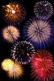 Het vuurwerk viert achtergrond Stock Foto