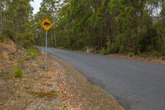 Het waarschuwen: Tasmaanse Duivel die teken kruisen Stock Afbeeldingen
