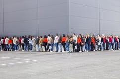 Het wachten in Lijn Stock Foto