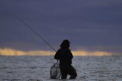 Het waden van visser Stock Afbeeldingen