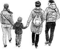 Het wandelen van de familie Stock Afbeeldingen