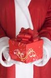 Het wapen van de Kerstman met heden Royalty-vrije Stock Afbeeldingen