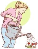Het water geven van de vrouw tuin Royalty-vrije Stock Fotografie