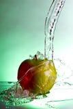 Het waterplons van de appel Stock Foto
