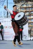Het wekken met horo - Bulgaarse traditionele dans Stock Foto