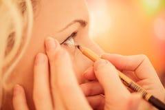 Het werk van de make-upkunstenaar Stock Foto