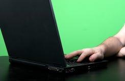 Het werk van de mens met laptop Stock Foto