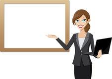 Het werk vrouwenpresentatie met whiteboard en computerlaptop Royalty-vrije Stock Foto's