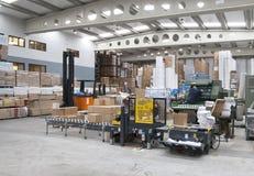 Het werken in een industriële drukinstallatie Stock Foto