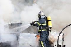 Het werken van brandbestrijders Royalty-vrije Stock Afbeeldingen