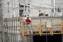 Het werken van de bouwvakker Stock Foto's