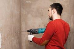 Het werken van de het effectboor van de muurboor, hamer royalty-vrije stock foto