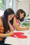 Het Werken van de Studenten van de kunst Royalty-vrije Stock Afbeeldingen