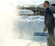 Het werpen van sneeuw stock foto