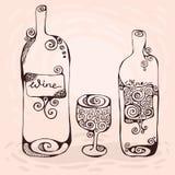 Het wijnglas en twee flessen wijn Stock Foto's
